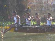 Snake boat oar men