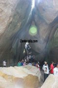 People view through the huge rocks of edakkal caves 111