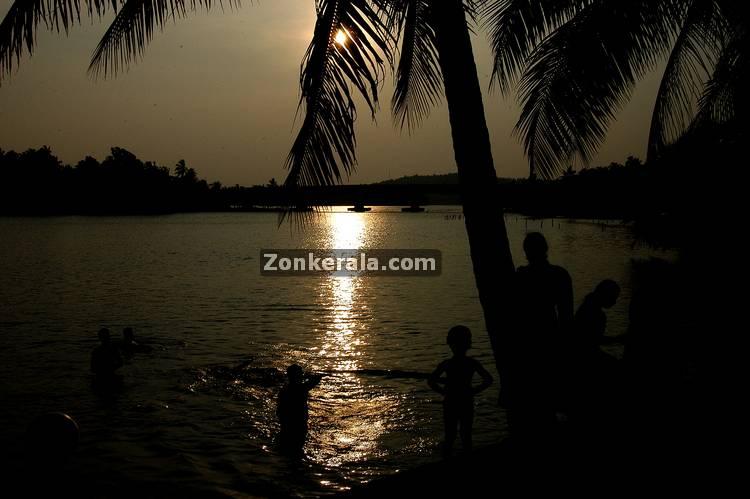 People taking bath in river in kerala