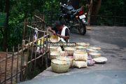 Woman making bamboo items